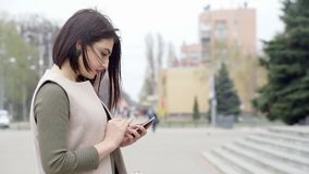 Woman with Smartphone stock footage