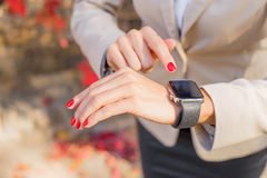 Woman with smartwatch on her hand Royalty Free Stock Photos