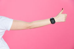 Woman with smartwatch showing thumb up on pink Stock Photos
