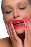 Woman with smeared lipstick Stock Photo