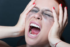 Woman with smeared mascara screaming Royalty Free Stock Photography