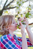 Woman smell flower outdoor Royalty Free Stock Photo