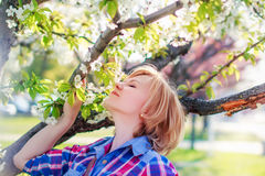 Woman smell flower from tree Royalty Free Stock Images