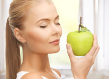 Woman smelling apple Royalty Free Stock Photo