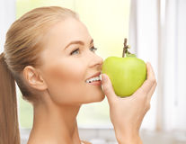 Woman smelling apple Royalty Free Stock Photos