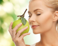 Woman smelling apple Royalty Free Stock Images
