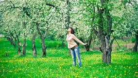 Woman smelling apple flowers Royalty Free Stock Photography