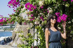 Woman smelling  bougainvillea   tropic flower Royalty Free Stock Photos