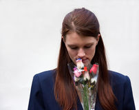 Woman Smelling Bouquet of Flowers Stock Photography