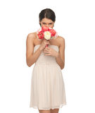 Woman smelling bouquet of flowers Stock Images