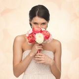 Woman smelling bouquet of flowers Royalty Free Stock Images