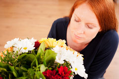 Woman Smelling a Bouquet of Flowers Stock Photos