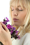 Woman smelling bunch of flowers Royalty Free Stock Image