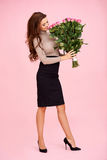 Woman smelling a bunch of roses Royalty Free Stock Images