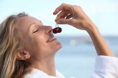 Woman smelling cherries Stock Photo