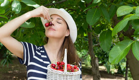 Woman smelling cherries. Royalty Free Stock Photo