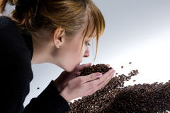 Woman smelling the coffee beans Stock Photo