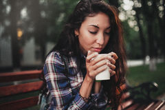 Woman smelling coffee Stock Photography