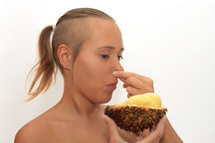 Woman smelling durian Stock Image