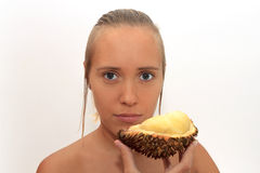 Woman smelling durian Royalty Free Stock Image