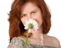 Woman smelling a flower Stock Photos