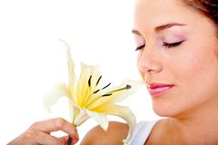 Woman smelling a flower Stock Photo