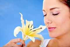 Woman smelling a flower Stock Photography