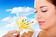 Woman smelling a flower Royalty Free Stock Images