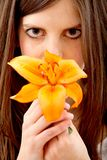 Woman smelling a flower Stock Images