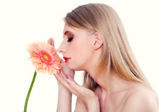 Woman smelling flower Stock Image
