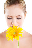Woman smelling flower Royalty Free Stock Images