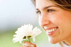 Woman smelling a flower Royalty Free Stock Photos