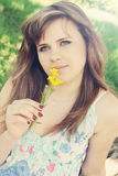 Woman smelling a flower Stock Image