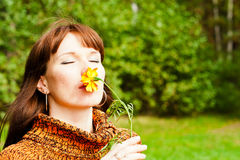 Woman smelling a flower Royalty Free Stock Image