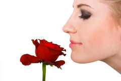 Woman smelling flower Stock Photography