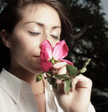 Woman smelling a flower Royalty Free Stock Photography