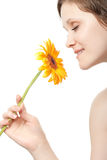 Woman smelling flower Stock Photo