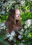 Woman smelling flower in the garden Royalty Free Stock Images