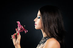 Woman Smelling a Flower Lily Royalty Free Stock Photography