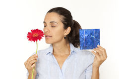 Woman smelling flower solar cell Stock Photos