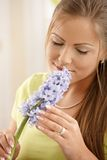 Woman smelling flowers Stock Photography