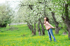 Woman smelling flowers Stock Image