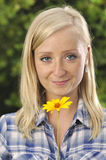 Woman smelling flowers. Royalty Free Stock Photos