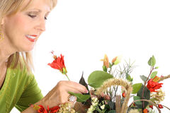 Woman smelling flowers Royalty Free Stock Images