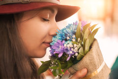 Woman smelling flowers bouquet Royalty Free Stock Photo