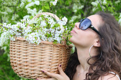 Woman smelling flowers in garden Stock Image