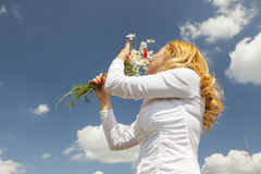 Woman smelling flowers Royalty Free Stock Photo