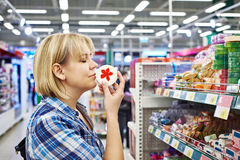 Woman smelling fragrant soaps in department of cosmetics. Woman smelling a fragrant soaps in the department of cosmetics Royalty Free Stock Photography
