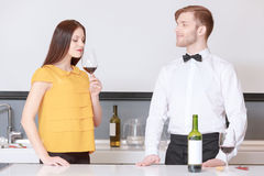 Woman smelling glass of wine Stock Photo