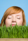 Woman smelling grass Stock Photography